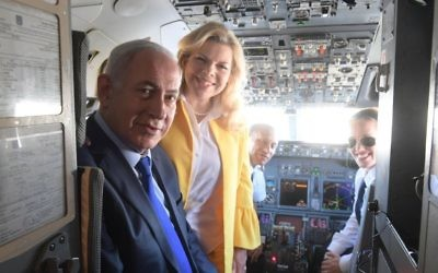 The Netanyahus pose with El Al's first female haredi Orthodox pilot. Screenshot/Twitter