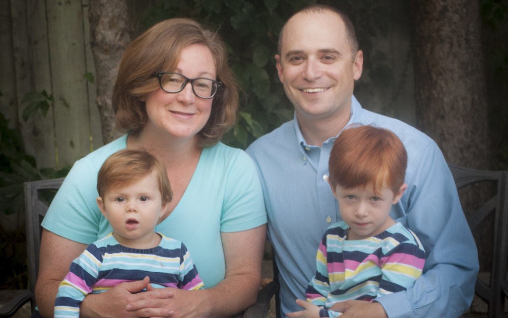 Rabbi Catherine Clark and her family. Clark had her first baby while studying at the Jewish Theological Seminary. (Steven Jack)