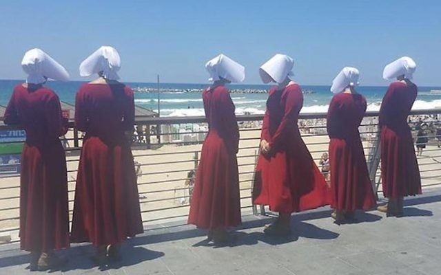 Handmaids at the beach in Tel Aviv, Israel, June 22, 2017. (Courtesy of HOT)