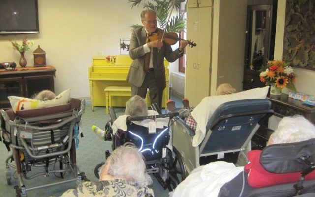 Cantor Vadim Tunitsky brings his violin and operatic voice to the infirm and home-bound in Houston, under the auspices of the local Jewish Family Service. STEVE LIPMAN/JW