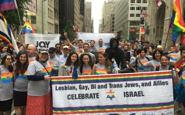 Participants march with the Jewish Queer Youth banner. Courtesy of Mordechai Levovitz