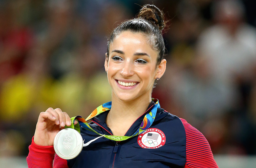 Aly raisman is the most famous jewish athlete according to espn aly raisman celebrates on the podium after winning a silver medal at the rio olympic arena m4hsunfo