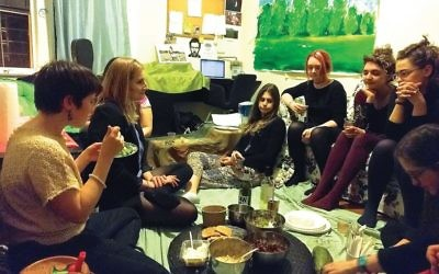 Shabbat their own way: Food, song and worship at Ronit Delgado's Brooklyn apartment. AMY SARA CLARK/JW