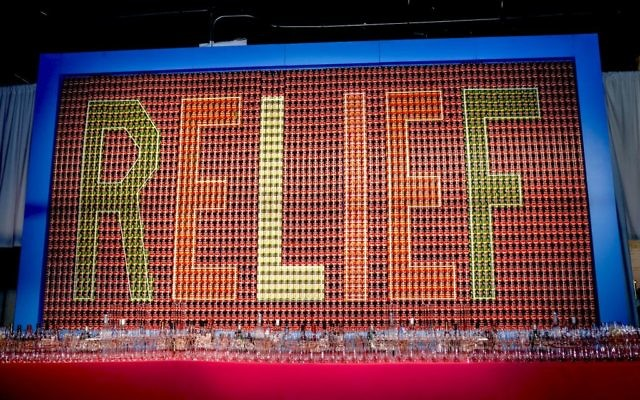"Cans spell ""Relief"" at recent UJA centennial event called Bash. Courtesy of UJA-Federation"