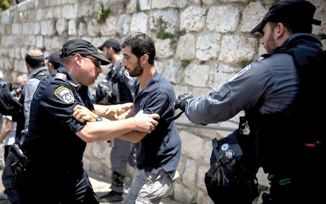 Israeli police trying to clear Muslim worshippers from the area of the Lions' Gate this past week after they performed their noon prayers outside the Temple Mount. JTA