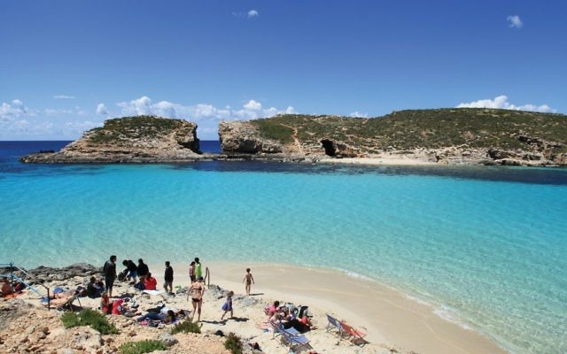 The Maltese option: A lagoon in Comino. Photos by Wikimedia Commons