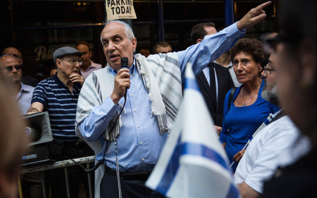 Rabbi Avi Weiss leading a vigil and march in New York City in remembrance of the three Israeli boys who were kidnapped and killed in the West Bank days earlier in June 2014. Getty Images