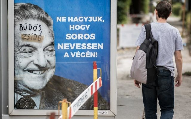 These anti-immigrant billboards in Budapest showing George Soros have been defaced with anti-Semitic graffiti. Courtesy of Open Society Foundations
