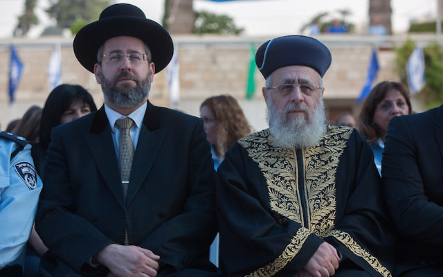 Sephardi Chief Rabbi Yitzhak Yosef, right, and Ashkenazi Chief Rabbi David Lau attending a New Year's ceremony at the national headquarters of the Israel Police in Jerusalem, Sept. 7, 2015. JTA