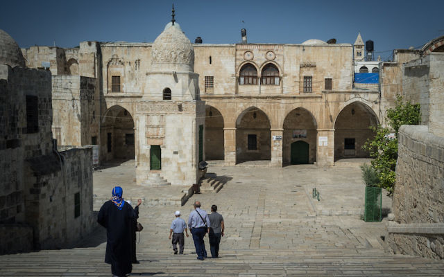 Muslims walk in the Al Aqsa Compound, known to Muslims as the Haram al Sharif, and to Jews as the Temple Mount, in Jerusalem's Old City, on July 18, 2017. The Temple Mount was reopened following last weeks terror attack when two Israeli Arabs opened fire and killed two Israeli police men. Metal detectors were placed at gates to the Temple Mount, and many Muslim worshippers are refusing to pass through them. Photo by Hadas Parush/Flash90