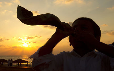 A young Jewish boy blows the shofar horn along the beach in the coastal city of Ashdod. Getty Images