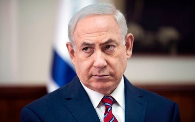Israeli Prime Minister Benjamin Netanyahu (L) attends the weekly cabinet meeting at his office in Jerusalem on May 14, 2017. Getty Images