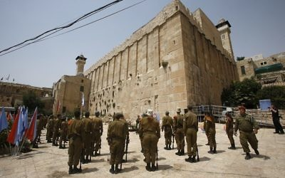 Israeli soldiers stand outside the Tomb of the Patriarchs in Hebron ahead of a demonstration against a UNESCO decision to add the heart of the city to the endangered world heritage list. UNESCO's heritage committee voted 12 to three -- with six abstentions -- to give heritage status to the Old City in the centre of Hebron. Getty Images