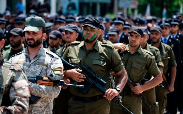 Hamas forces take part in a military parade in Gaza City on July 26, 2017 as a tense standoff was underway between Israel and Muslim worshippers at the Temple Mount compound. Getty Images