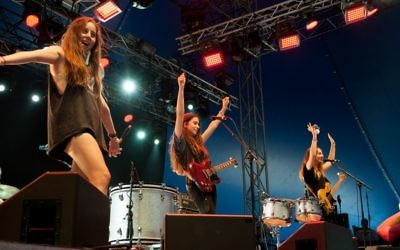 HAIM performing in 2013. Wikimedia Commons