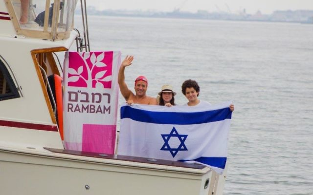 Guy Cohen, left, with children Noa, center, and Matan on the day of the swim. Judah S. Harris