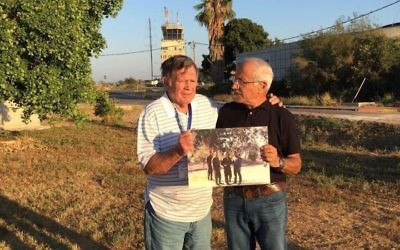 "Retired U.S. fighter pilot Roy ""Bubba"" Segars, left, and retired Israeli fighter pilot Jacob ""Booby"" Daube holding a photo they took together during the 1973 Yom Kippur War at the same Tel Nof air base in Israel, June 28, 2017. (Courtesy of IDF Spokesperson)"