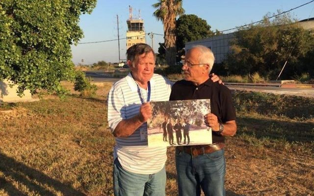 """Retired U.S. fighter pilot Roy """"Bubba"""" Segars, left, and retired Israeli fighter pilot Jacob """"Booby"""" Daube holding a photo they took together during the 1973 Yom Kippur War at the same Tel Nof air base in Israel, June 28, 2017. (Courtesy of IDF Spokesperson)"""