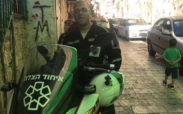 Nedal Sader sitting on his United Hatzalah motor-scooter in the Old City of Jerusalem, July 14, 2017. (Andrew Tobin)
