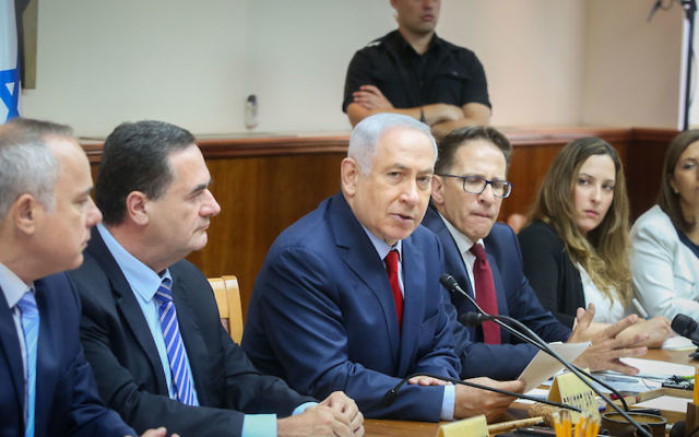 Benjamin Netanyahu, center, leading the weekly cabinet meeting at the prime minister's office in Jerusalem, June 25, 2017. JTA