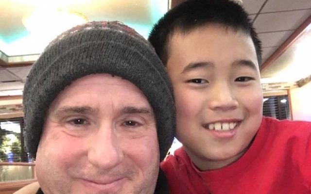 Daniel Beer, 11, pictured here with his father, died after falling ill at a Jewish summer camp. JTA