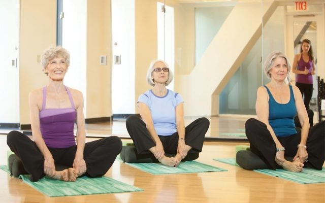 Participants take part in a Yoga for Bone Health & Osteoporosis class at the JCC Manhattan. Courtesy of Nancy Adler/JCC Manhattan