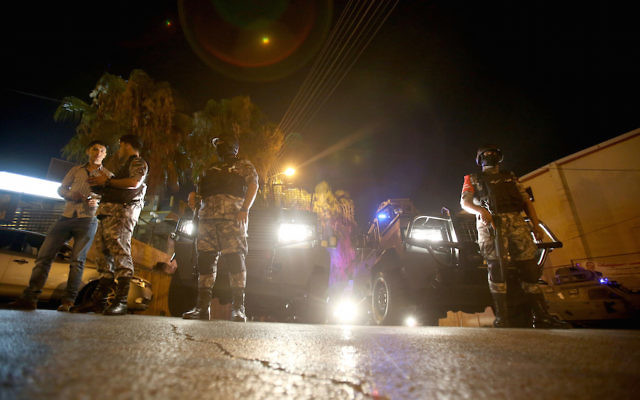 Security forces outside the Israeli Embassy in the Jordanian capital Amman following a stabbing attack, July 23, 2017. (Khalil Mazraawi/AFP/Getty Images)