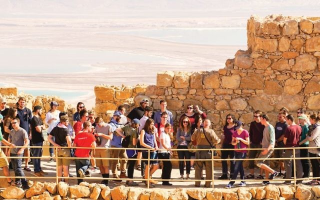 Upon this rock: A recent Passages group at Masada. Courtesy of Passages