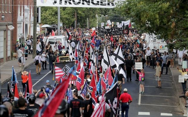 White nationalists, neo-Nazis and members of the alt-right march down East Market Street over the weekend of Aug 11-12 in Charlottesville, Va. in 2017. Getty Images