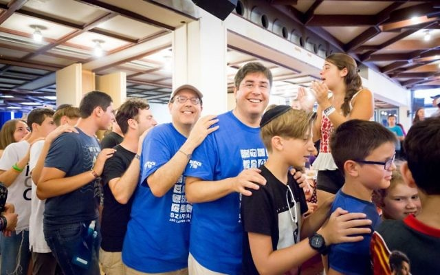David Schizer, CEO of the American Jewish Joint Distribution Committee, and Eric Goldstein, CEO of UJA-Federation of New York, dancing with students at Szarvas International Jewish Summer Camp in Hungary. Courtesy of JDC