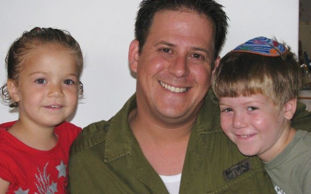 Elad Salomon, who was killed in the Halamish attack, with two of his children. Facebook