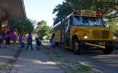Children returning back to school. Courtesy of U.S. Air Force Photo/Staff Sgt. John Bainter
