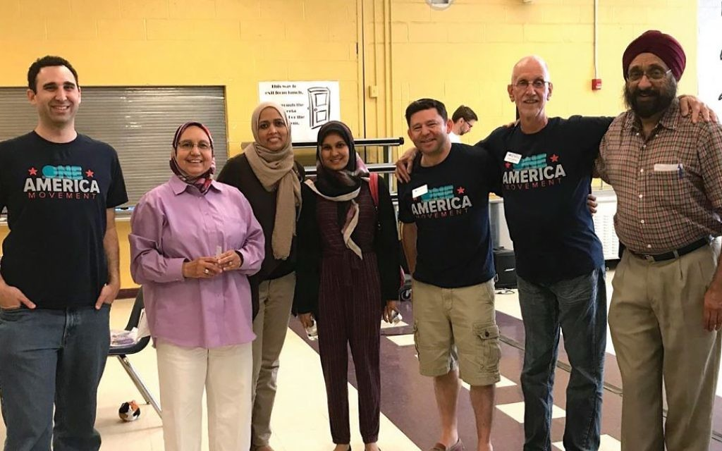 A diverse group of One America Movement volunteers at an event last month in Cherry Hill, N.J. Courtesy of the One American Movement