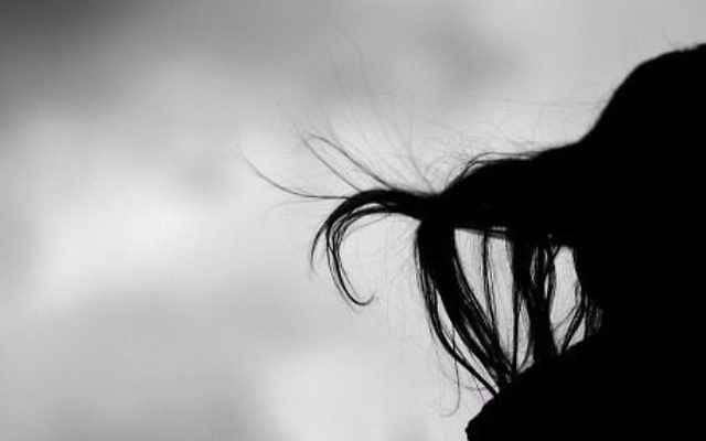 Silhouette of woman's hair in wind, Getty Images.
