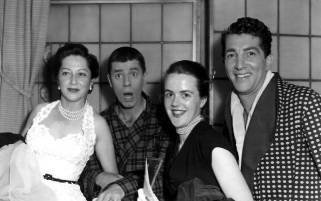 American singer and actor Dean Martin and a clowning Jerry Lewis stand with Mrs Val Parnell and Mrs Clodagh Haherty in 1953. Getty Images