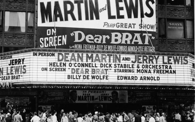 A crowd gathers to see Dean Martin and Jerry Lewis in person and on a double bill with the movie 'Dear Brat,' starring Mona Freeman, Billy De Wolfe, and Edward Arnold, New York, New York, 1951. Getty Images