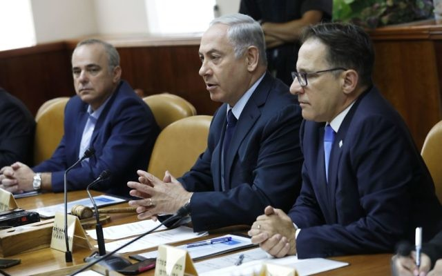Israeli Prime Minister Benjamin Netanyahu (C) chairs the weekly cabinet meeting at his office in Jerusalem on July 30, 2017. Getty Images