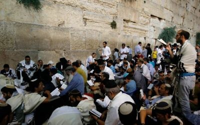 Orthodox Jewish men pray at the Western Wall in Jerusalem's Old City on July 31, 2017 on Tisha B'Av   eve. Getty Images