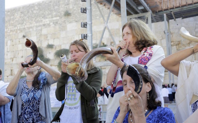 Anat Hoffman blowing a shofar at the Western Wall in Jerusalem, Aug. 23, 2017. Courtesy of Women of the Wall
