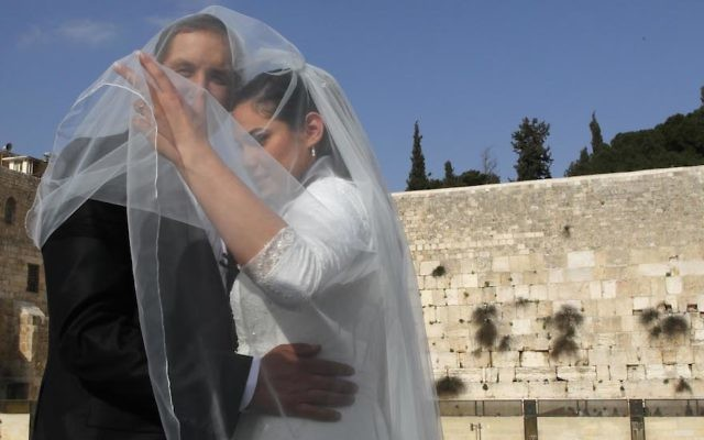 A groom and bride taking wedding pictures at the Western Wall in Jerusalem, April 13, 2011. (Nati Shohat/Flash90)