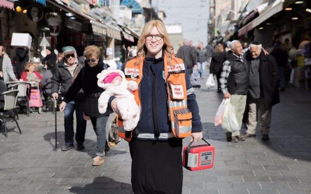 Miriam Ballin, holding her baby daughter, at the Mahane Yehuda market in Jerusalem. (Courtesy of Ballin)