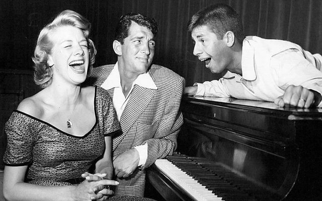 Rosemary Clooney, Dean Martin and Jerry Lewis from the radio and television program The Colgate Comedy Hour, circa 1952. In television's early days, programs were often broadcast on radio and television. Martin and Lewis were the hosts of the show at this time. Wikimedia Commons