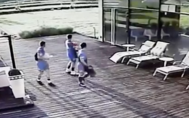 Players on the Hapoel Petach Tikvah team seen on a security camera after playing a match in Poland. (Screenshot from YouTube)