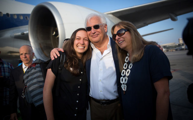 U.S. Ambassador to Israel David Friedman, with wife Tammy, greets his daughter and new Israeli immigrant Talia Friedman on her arrival at Ben Gurion Airport, Aug. 15, 2017. (Miriam Alster/Flash90)
