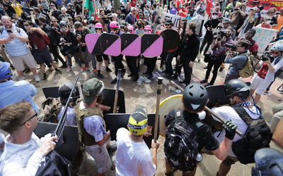 "White supremacists, foreground, face off against counter-protesters, top, at the entrance to Emancipation Park during the ""Unite the Right"" rally in Charlottesville, Va., Aug. 12, 2017. JTA"