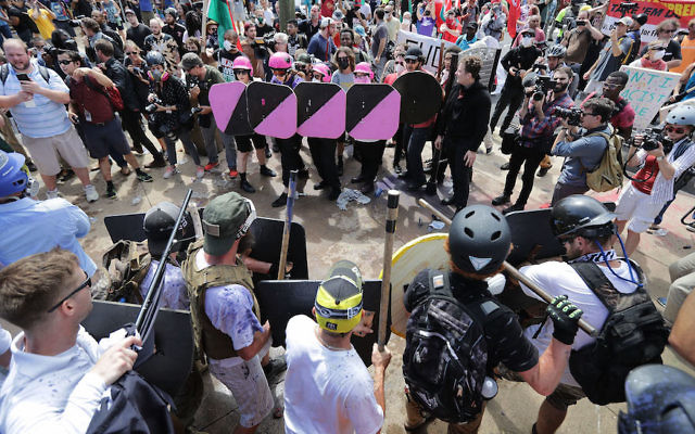 """White supremacists, foreground, face off against counter-protesters, top, at the entrance to Emancipation Park during the """"Unite the Right"""" rally in Charlottesville, Va., Aug. 12, 2017. JTA"""