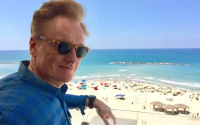 Conan O'Brien overlooking the beach in Tel Aviv, Israel, Aug. 26, 2017. JTA