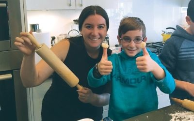 Kayla Kirshenbaum, an experienced educator at Stephen Wise Free Synagogue Religious School, is among a group of teachers from the school who taught lessons at members' home during the last academic year. Here, she makes hamantaschen with Portals' third-grader Ethan Furman. Photo courtesy Stephen Wise Free Synagogue
