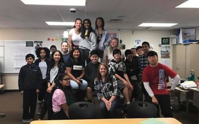 Megan Corbin, shown in front center with her Seattle-area language arts class, emphasizes the individual choices involved in the Holocaust. Courtesy of Megan Corbin
