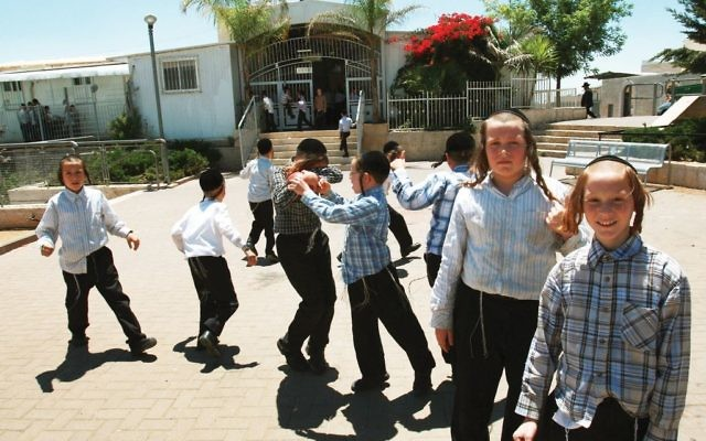"Children at a charedi school in Israel. A study of textbooks used in such schools is coming under fire for ""fighting modernity, the central enemy, through textbooks."" Getty Images"